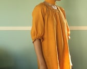 saffron dress with hand pleated neckline