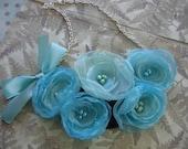 Soft and feminine fabric flower bib style statement necklace