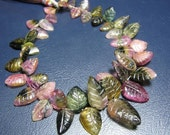 7inches,Bi Tourmaline Carved Leaf,1 full strand size is approx,13mm to 6mm,A Grade quality.