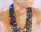 Multi-strand Black Seed Beads with African Trade Bead Necklace