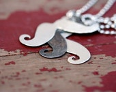 A set of whimsical mustache necklaces sterling silver