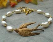 Sky is the limit  Vintage Brass bird Peace pearl Bracelet