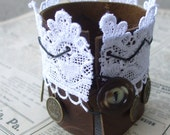 Lace n Leather Cuff -- romantic chocolate and white bracelet with brass metal sailing ship and queen coins. Pretty, unique, adjustable. LAST ONE.