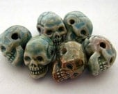 4 Raku skulls - tiny ceramic beads