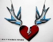 vintage tattoo style sparrows holding broken heart necklace