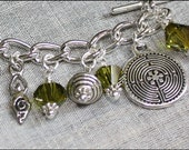 Ancient Symbol Silver Charm Bracelet with Olivine green Swarovski Crystals