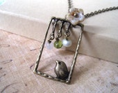 Sale....Antique Brass Bird Perches on The Window Necklace