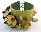 Leather bracelet. Leather floral cuff bracelet. Yellow and green color corsage.