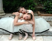 Ballerinas Embrace -  fine art photography -  two ballerinas in cream tulle gowns with black ribbon accents . 8x12
