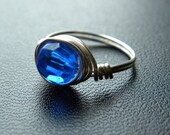 Cobalt blue faceted ring  wrapped in silver