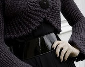 Elegant black sweater with one button in front