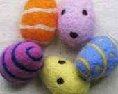 EASTER EGG, needle felted from wool in fuchsia pink with cobalt blue spiral stripe