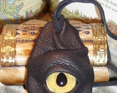 Dragon eye pendant (Black leather with sandstone eye)