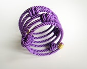 Rope wrapped memory wire cuff bracelet with knots purple