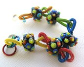 Lolly - Rainbow lampwork bumpies with bright multi-colored coiled wire bracelet - Jenniflair original