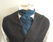 "70"" Cravat, in peacock blue.  A formal tie for your wedding costume.  Extra long for the big and tall gentleman."