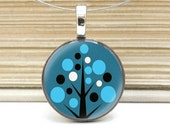 festive blue tree necklace on repurposed nickel