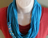 Turquois blue circle t-shirt infinity scarf with a matching braid for extra style.