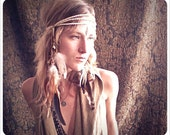 hawk tribe. a tribal feathered headdress and necklace.