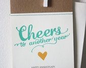 Happy Anniversary Stitched Greeting Card: 'CHEERS to another year.'