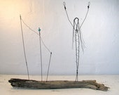 "Wire Sculpture - Titled ""Celebrate Life"". Mixed Media Sculpture mounted on Driftwood from the Atlantic. One of a kind."