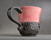 Curvy Dottie Mug: Pink and Clear Black Curvy Dottie Mug by Symmetrical Pottery