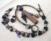 The World. Primitive Rustic Tribal Gypsy Assemblage with Japanese stamp, tourmaline.