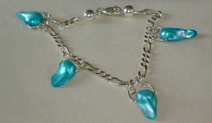 Bright blue pearl shell beads on sterling silver bracelet