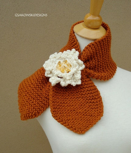 Brown knit scarflette with white flower, via Etsy: gsakowskidesigns