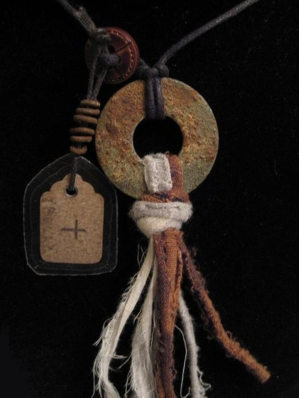 urban shaman's amulet with vintage tag and rusty wire