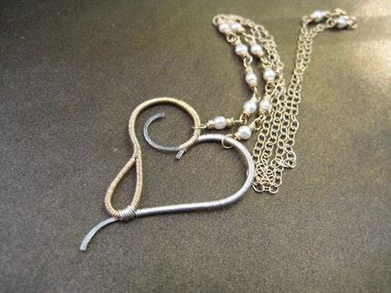 Terpsichore - mixed metal heart necklace