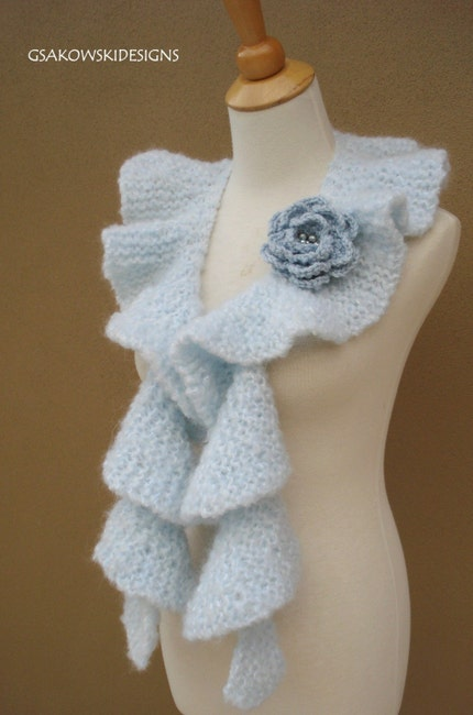 Pale blue ruffle scarf with blue flower pin, via Etsy: gsakowskidesigns