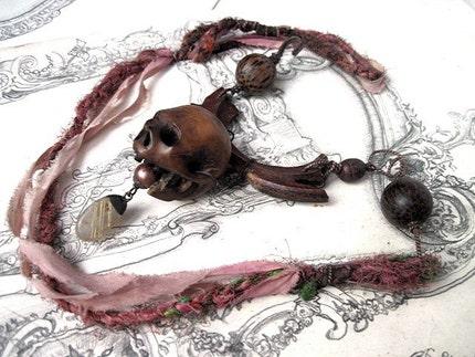 Calavera.  Wood and Sari Yarn Assemblage.