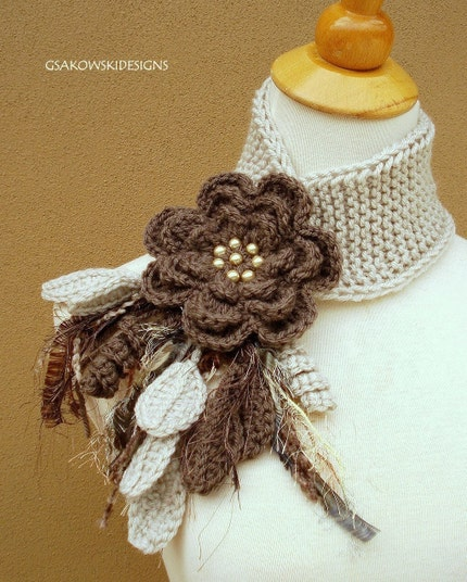 Oatmeal scarf with brown flower pin, via Etsy: gsakowskidesigns