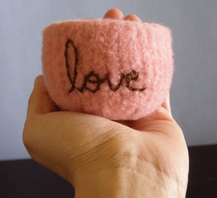 fuzzy felted pink wool bowl with the word love embroidered in milk chocolate brown