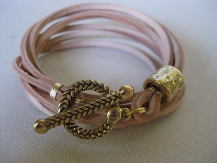 Thick tan leather wrap bracelet with antique gold toggle and bead