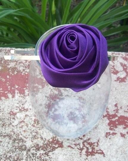 A satin purple rose headband from Etsy.