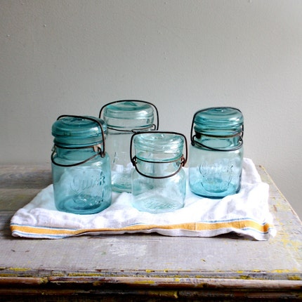 Collection of Blue Mason Jars in a Fruit Box