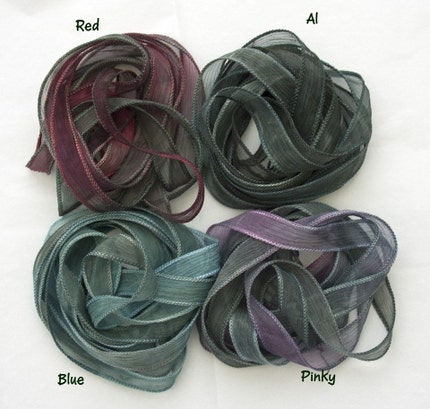 Four pure silk ribbons all with a base of variegated greys