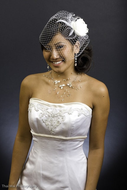or maybe a birdcage veil. x x. P.s project wedding is great for pics!