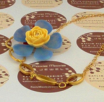 Blue and Buttercream Yellow Flower Set on a Collar Bone Women
