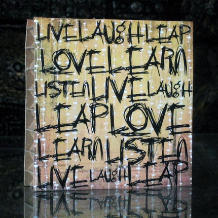 LIVE LAUGH LEAP LOVE LEARN LISTEN scribbled on recycled hexacomb packing