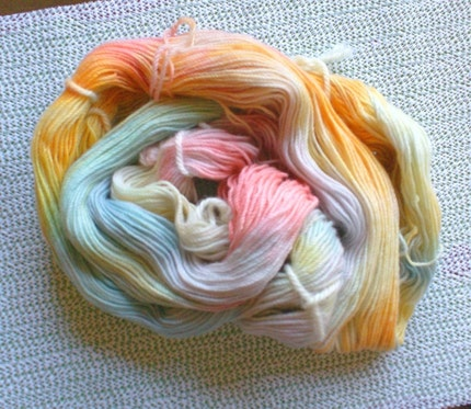 An unwound hank of yarn, showing the long loops of hand dyed yarn