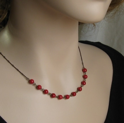 Draped in Red Berries - Hand linked red glass and brass necklace by TheBrassHussy on Etsy from etsy.com