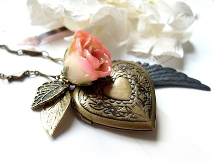 Genova. Gorgeous peach rose bud with heart shaped antiqued brass locket and angel wing and leaves necklace
