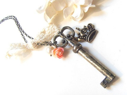 Queen of Couture. Antiqued victorian skeleton key pendant with a romantic crown charm necklace.