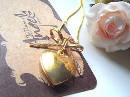 Coeur. Vintage heart shaped french locket with romantic brass ribbon necklace.