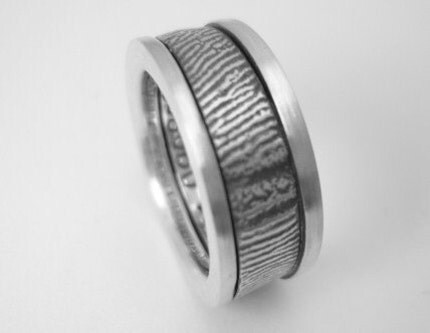 Custom fingerprint wedding band with sides and text inside