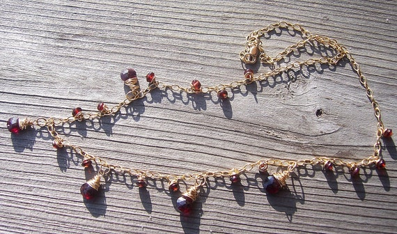 Garnet and gold wire wrapped necklace