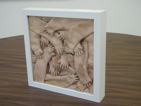 framed vintage doll hands in bright white shadow box